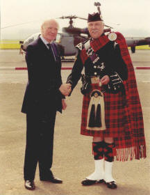 Jim receives his medal from Sir Menzies Campbell MP